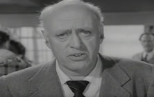 Alastair Sim as Stephen Potter addresses the film audience
